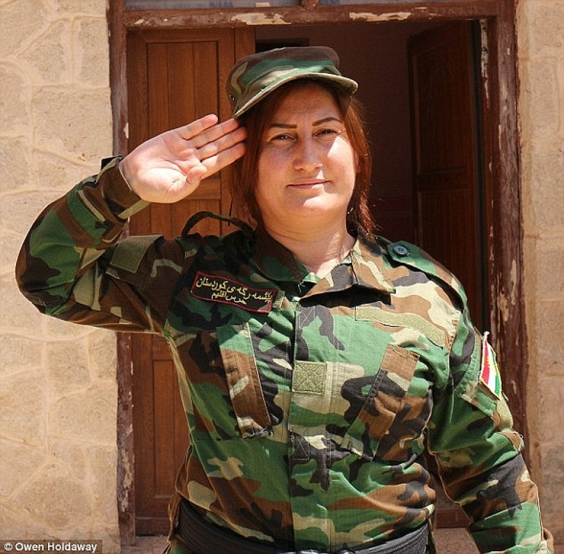 Leader: The brigade's founder and commander is Xate Shingali (pictured), a renowned singer who performed traditional folklore music all over northern Iraq