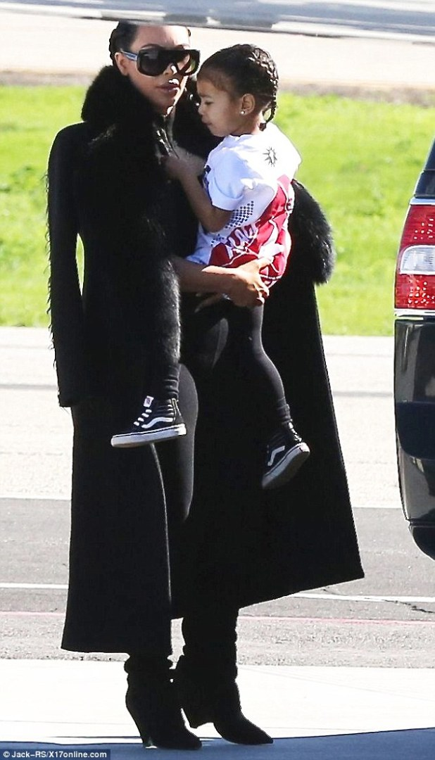 Back in the spotlight: Kim Kardashian, who has rarely been seen in public since the birth of her son Saint in December, was pictured jetting out of LA for New York on Tuesday