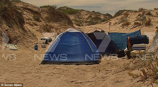 Police called to the terrifying incident after the local roadhouse receiving a 'panicked' phone call from a group of fishermen on the beach found this campsite along with a seriously injured woman