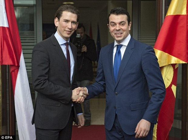 Macedonian Foreign Minister Nikola Popovski (right) welcomes his Austrian counterpart Sebastian Kurz  in Skopje. Mr Kurz demanded Macedonia 'completely stop' the flow of migrants across its border from Greece