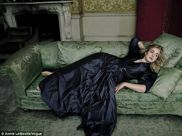 'I feel so comfortable in my own skin': Adele emulated 'a Pre-Raphaelite damsel' lounging in a crumbling castle for a new Vogue spread shot by Annie Leibovitz