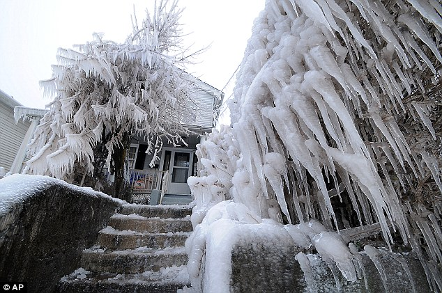 Icicles were left dangling from tree branches and power lines while the sidewalk and properties were covered with a thick layer of ice before crews could shut the water off at around 3pm yesterday