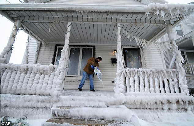 Homeowners in Scranton, Pennsylvania, awoke to find their homes covered in ice yesterday after a pipe burst overnight spraying water up to 20ft in the air in freezing temperatures
