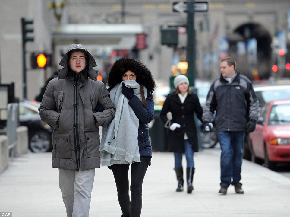 Benedikt Vom Orde and Julia Felte, tourists from Essen, Germany, walk along Park Avenue in New York during a bitter cold spell on Saturday