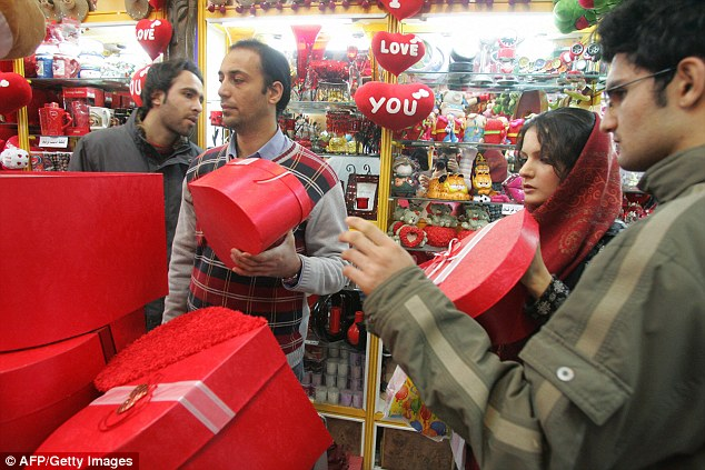 On Friday Iranian news outlets reported police had released a directive warning retailers against promoting 'decadent Western culture through Valentine's Day rituals' (pictured: Shoppers in Tehran in 2008)