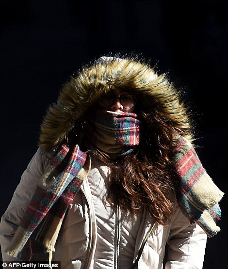 Some people opted for large scarves and hoods to brace themselves from the cold in New York City on Sunday