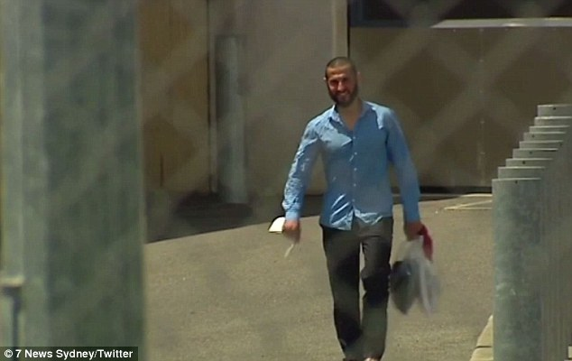 Dib (pictured) walked out of the prison while holding a plastic bag filled with items in one hand