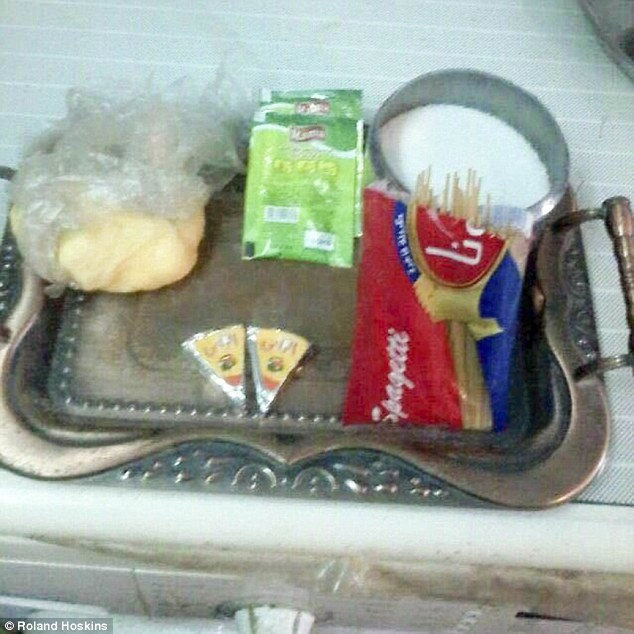 Scraps: The government rations are woefully inadequate - justa handful of spaghetti, two triangles of processed cheese, 200g of margarine, 100g of sugar and 2 sachets of dried orange cordial for a month