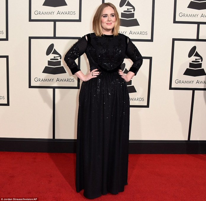 She's back: Adele made a triumphant comeback in a long-sleeved black Givenchygown which was adorned with sequins