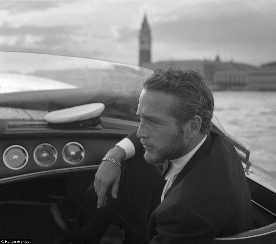 Legendary American actor Paul Newman, wearing a tuxedo and a bow tie during a trip on a water taxi with St. Mark Square in the background, Venice 1963