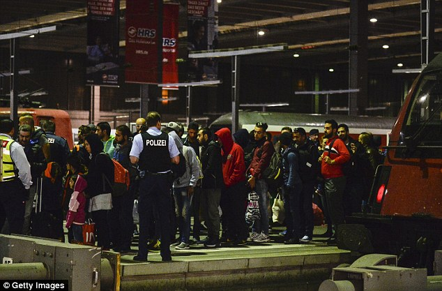 Currently the government pays a lump sum of £70 for every asylum seeker treated. However, it is estimated the true cost lies closer to £155. Pictured are migrants arriving in Munich by train