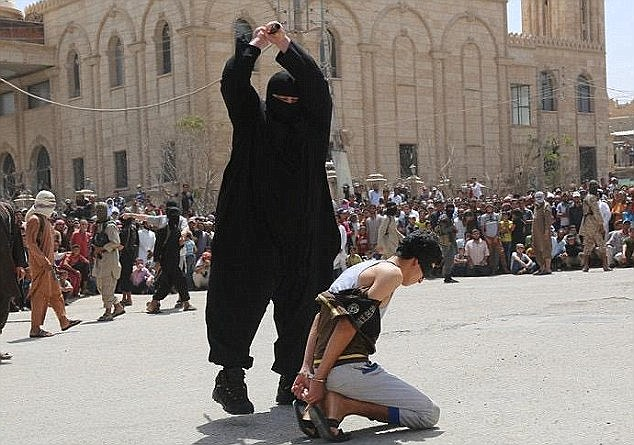 A teenage boy has been beheaded by ISIS for  listening to Western music (file picture of different execution)