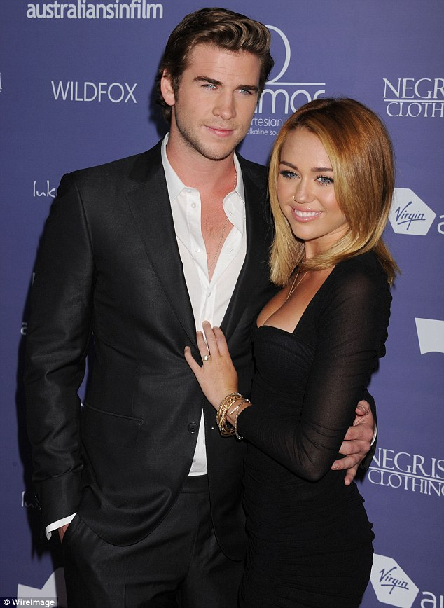 Young love: Miley and Liam got engaged in June 2012 after three years of dating on and off. They are pictured here later that month. The two stars confirmed their split in September 2013