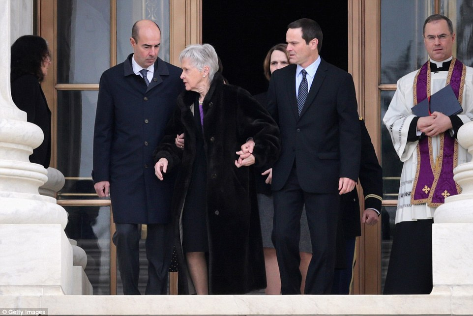 Grieving: A frail Maureen Scalia, the widow of the Supreme Court Justice, was escorted out of the court by family members