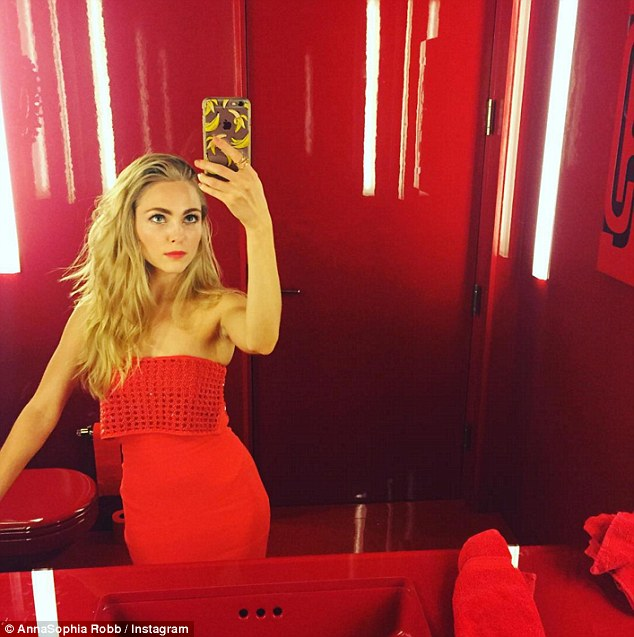 Red alert! The star sported much longer hair until recently - here she is pictured in a selfie shared in November