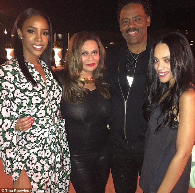 Love around: TIna shared a picture on Instagram as she posed alongside Kelly, her actor husband Richard Lawson, 68, and step daughter Bianca Lawson, 36,