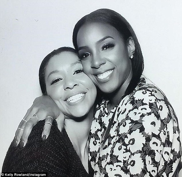 Womanly embrace: Kelly shares a sweet smile with a female party guest