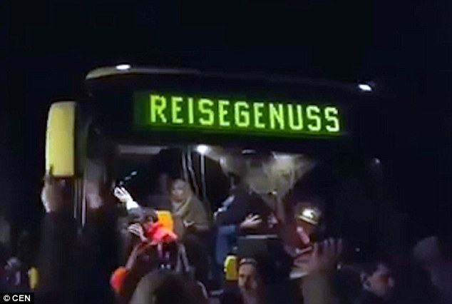 Fury: A 100 strong mob chanted'We are the people' and 'Go home' as the 20 refugees disembarked the bus inClausnitz, eastern Germany, where they will be housed in a new asylum centre