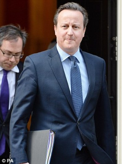 Set to be defied:Local councillors lined up to say they were 'hacked off' with Mr Cameron (pictured leaving Downing Street yesterday)