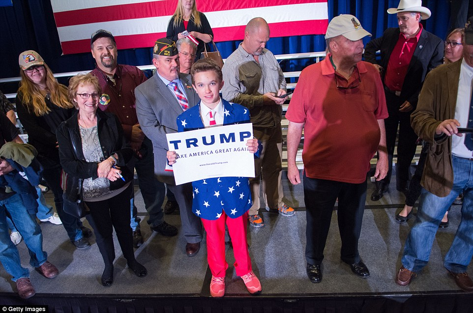 He's got the young vote:A Trump fan poses for a photo following a rally at the Nugget earlier today - even though he will be too young to cast his vote tonight