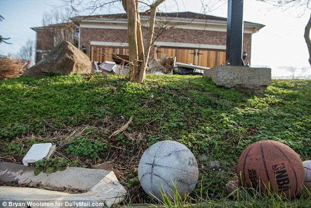 Among the junk littered on the law, long-neglected basketballs