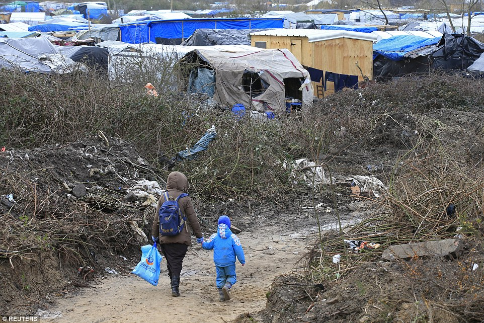 Today the French courts gave permission for part of the Jungle (pictured) to be demolished, forcing people into the new temporary housing near the camp, in Calais