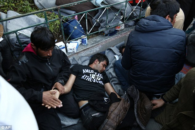 The men, one of whom was unconscious, were rushed to hospital from the square, a common destination for migrants when they reach Athens from the Aegean Sea islands