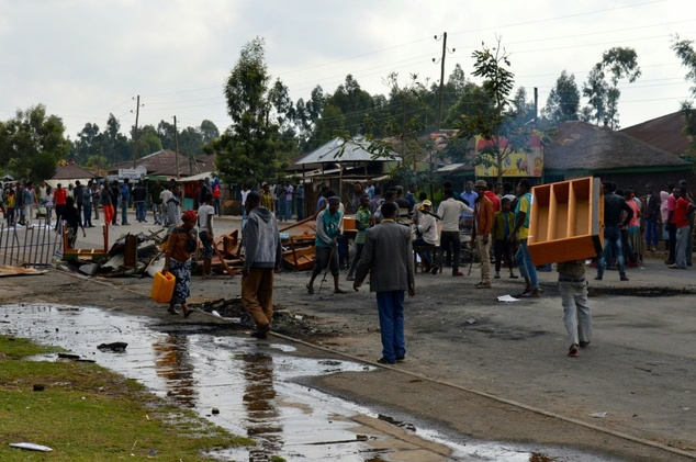 Ethiopians from the Oromo group block a road  after protesters were shot dead by security forces in Wolenkomi, west of Addis Ababa
