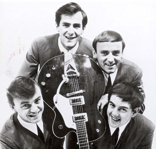 Les Maguire, second left, the keyboardist of Liverpool group Gerry and the Pacemakers, found the band's record in his loft
