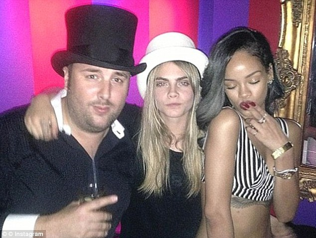 Celebrity haunt: Cara Delevingne and Rihanna are among the stars that frequent nightclub Cirque le Soir. Pictured, the pair with the ringmaster of the circus themed club, Tom Eulenberg