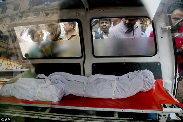 The bodies of two of the 14 relatives who were murdered by Hasnin Anwar Warekar before he killed himself