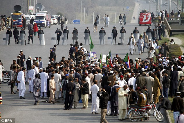 In the port mega-city of Karachi, protesters blocked main intersections and some petrol stations were closed after Qadri supporters ordered them shut