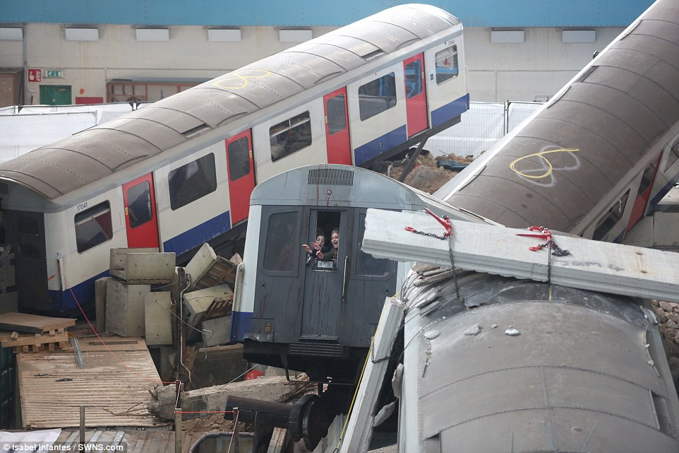 Trapped: Passengers who were caught inside their carriage when the building 'collapsed' are seen screaming for help