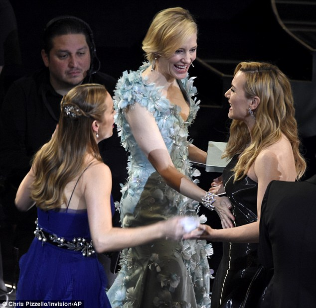 So happy! Cate reaches forward and places her hand on Kate's stomach, leading some to believe the actress is pregnant