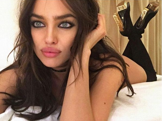 One way to relax: Irina Shayk thrilled fans by sharing a very racy picture of her relaxing after the Versace runway show over the weekend in just a pair of the brand's boots