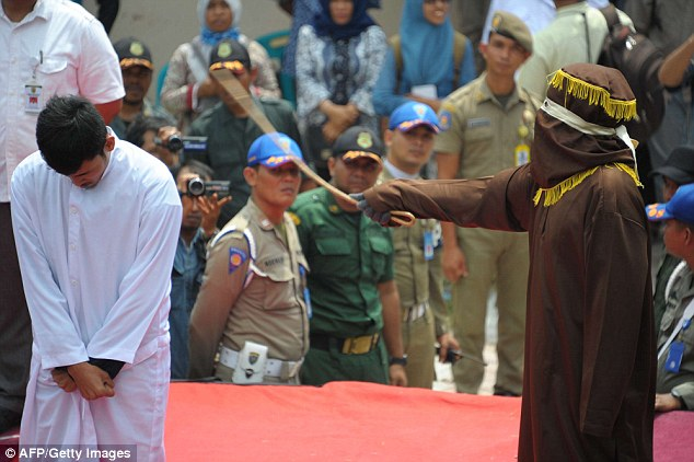 Breaking the law: The couple were among 18 people lashed in publish for breaking the Indonesian province's strict implementation of Islamic Sharia law on Tuesday
