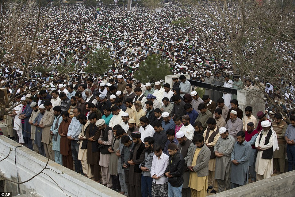 Supporters of Qadri pray in unison during his public funeral inRawalpindi, a city next to Islamabad
