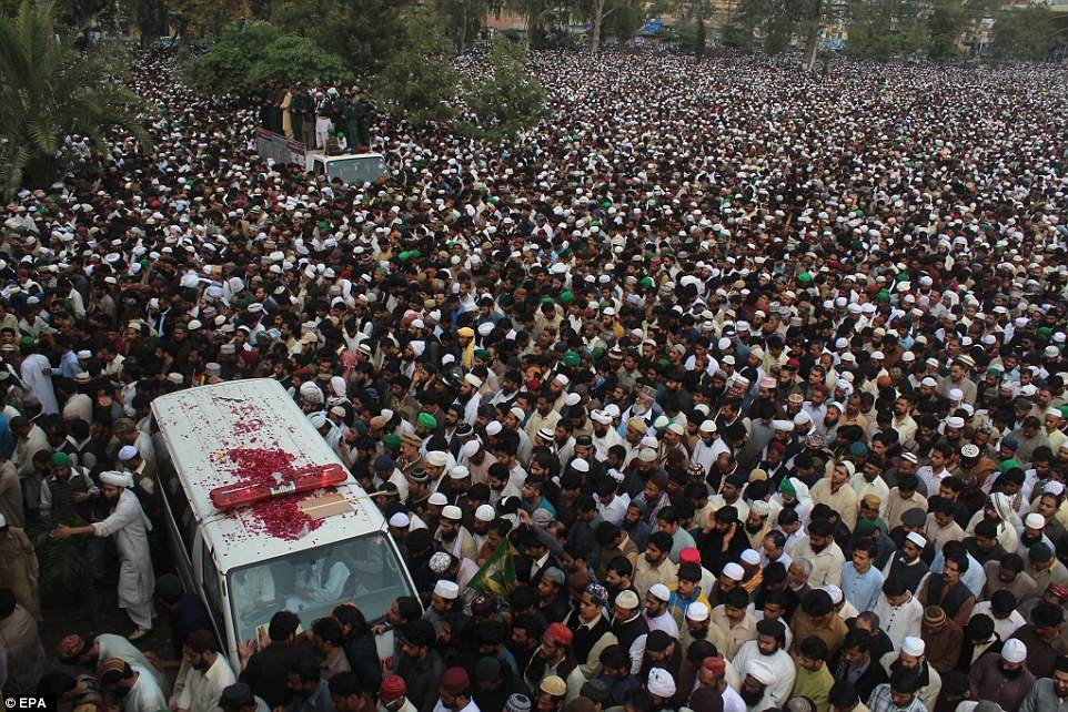 Thousands of mourners gather in Rawalpindi, Pakistan to celebrate the killer Mumtaz Qadri who was executed yesterday. Pictured bottom left is an ambulance carrying his body as it snakes its way through the mass of people