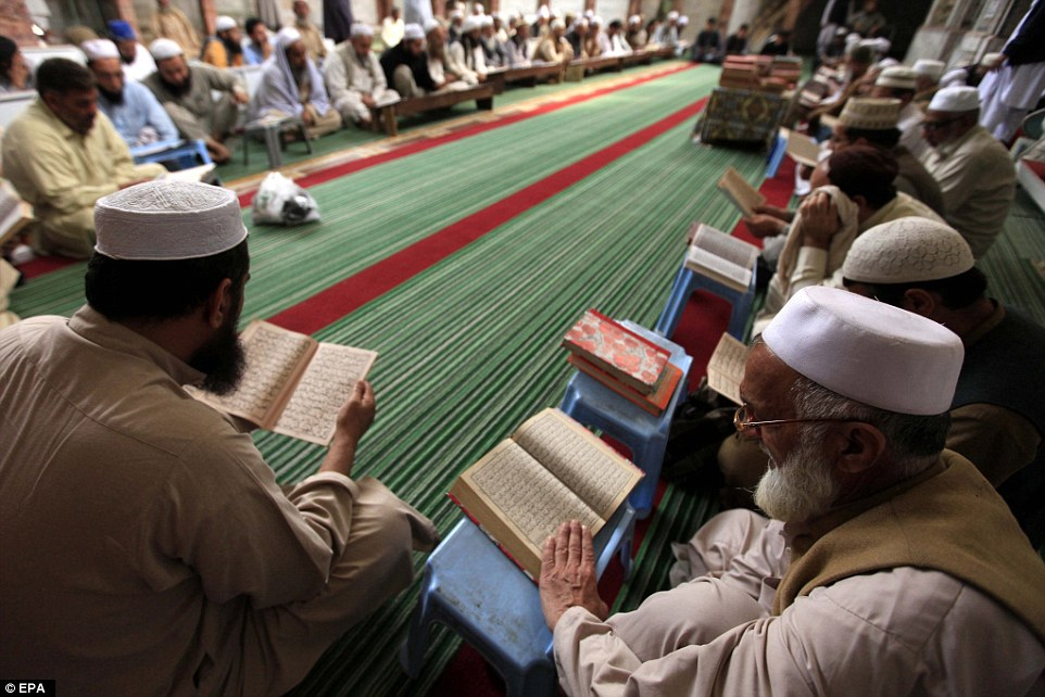Qadri was loved by many of the country's conservatives eager to prevent a loosening of the country's blashemy laws. Pictured are his supporters reading from the Koran in Peshawar