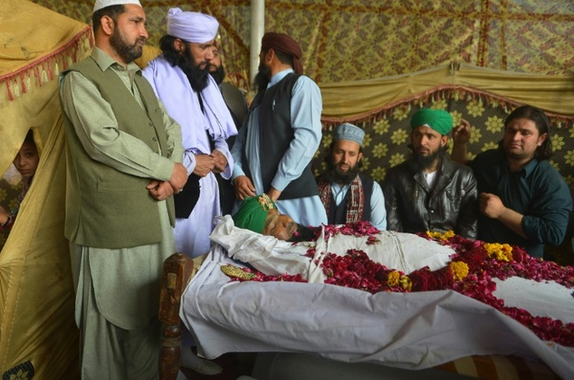 Relatives and supporters gather around the body of convicted murderer Mumtaz Qadri following his execution, in Rawalpindi, on February 29, 2016