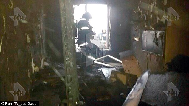 Pictures have emerged showing the burnt our interior of the Moscow flat where the child's headless body was found