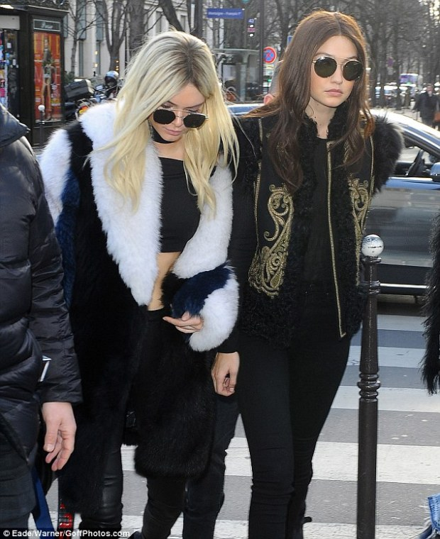 Opposites attract: Blonde bombshell Kendall Jenner and newly-brunette Gigi Hadid continued to parade their new hair colours as they headed out for lunch in Paris, France, after storming the runway at Balmain's show