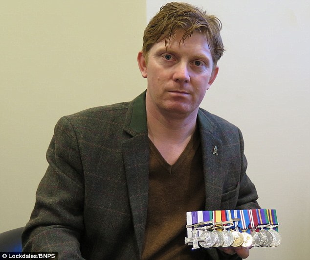 Ex-Colour Sergeant Trevor Coult, 41, (pictured) from Woodbridge, Suffolk, was awarded the Military Cross for fighting off suicide bombers and gunmen who ambushed his convoy in Baghdad in 2005