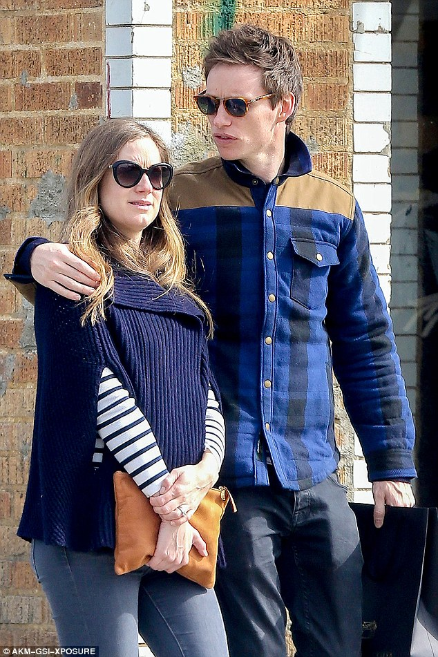 Simply smitten: Eddie nd his pregnant wife Hannah put on a loving display during a low-key shopping spree in Los Angeles, California, earlier in the week