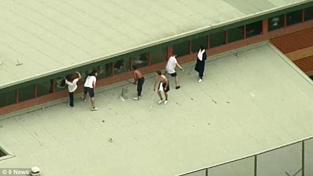 A group of six boys rioted on the roof of the Youth Justice Centre in Melbourne (pictured) after climbing up there with metal poles on 2.30pm on Monday