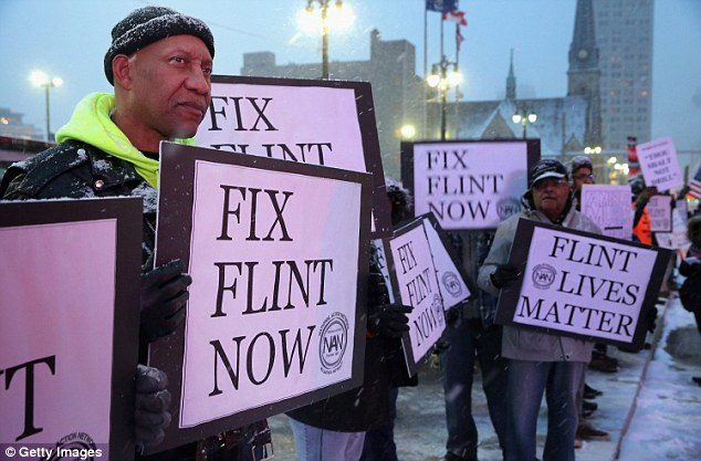 Demonstrators demand action from the Republican presidential candidates about the water crisis in Flint, Michigan on March 3 (file photo)