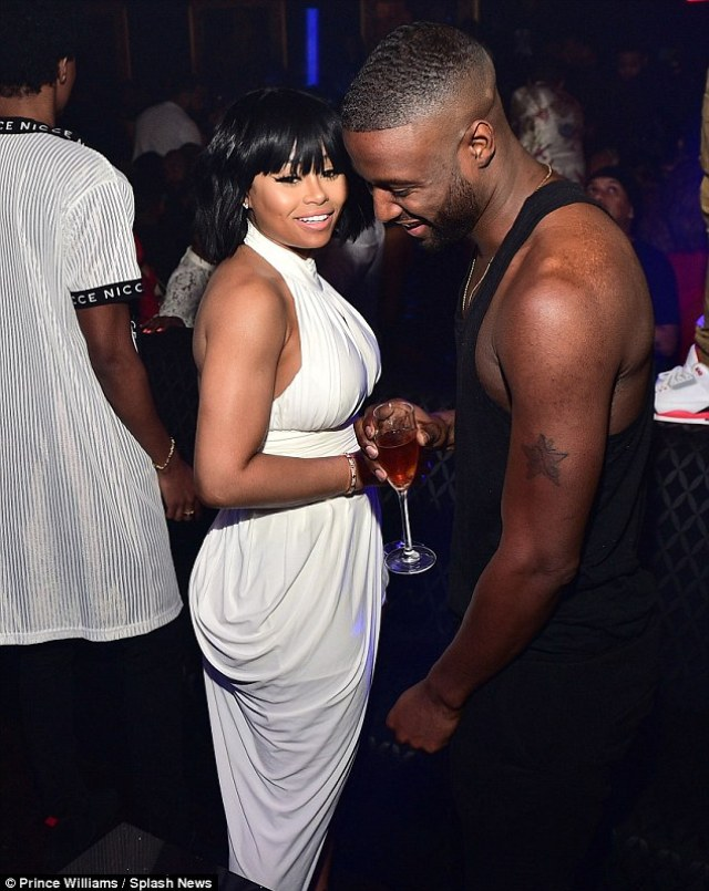 Partying the night away: Meanwhile, Blac Chyna was in Atlanta, hosting a club night and chatting to a male model
