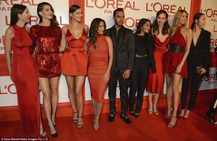 Red obsession: (From left) Bianca Balti, Isabeli Fontana, Irina Shayk, Eva Langoria, Lewis Hamilton, Leila Bekhti, Natasha Poly and Xiao Wen Ju led the red obsession