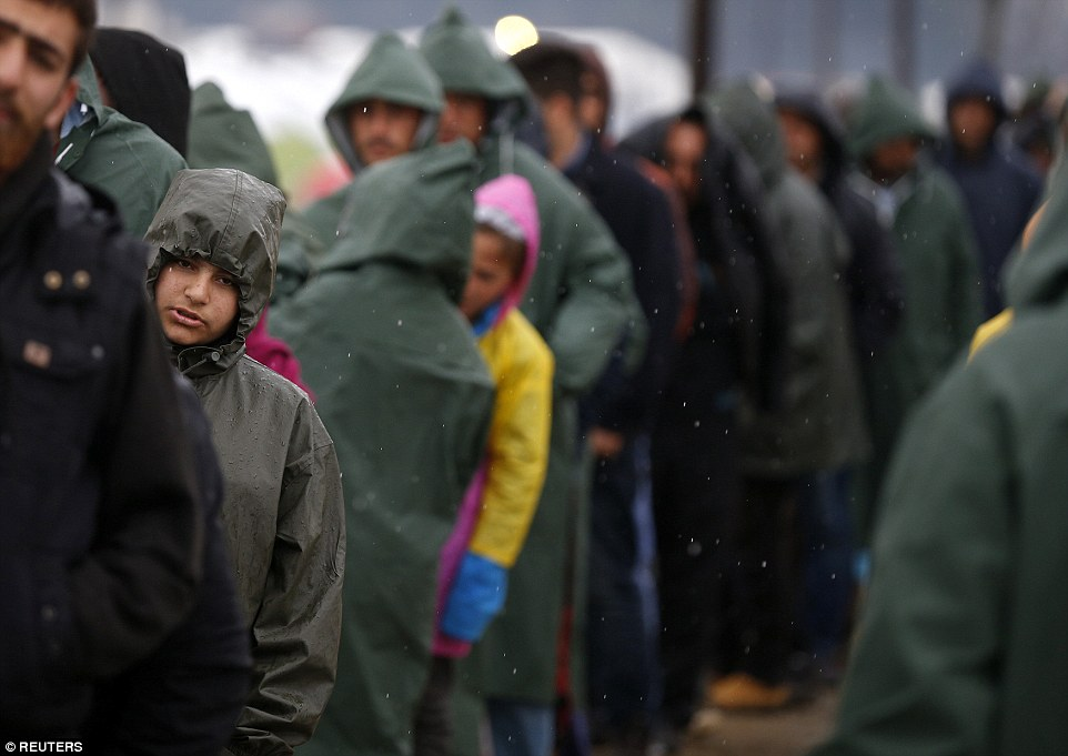 The tightening of border restrictions in recent weeks sparked by Austria's move has created a bottleneck at the border with Macedonia where more than 13,000 people were stranded at the camp at Idomeni (above)