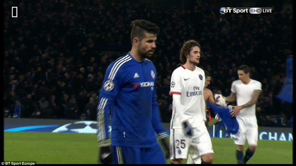 Hazard infuriated the Chelsea fans after swapping shirts with Angel di Maria (right) just after the half-time whistle